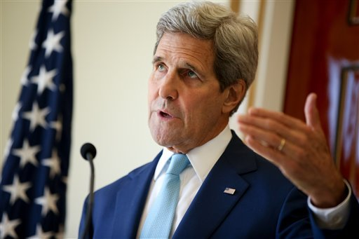 In this May 6, 2015 file photo, U.S. Secretary of State John Kerry speaks during a joint press conference with Foreign Minister Mahamoud Ali Youssouf at the Presidential Palace, in Dijbouti, Dijbouti. The State Department says Secretary of State John Kerr