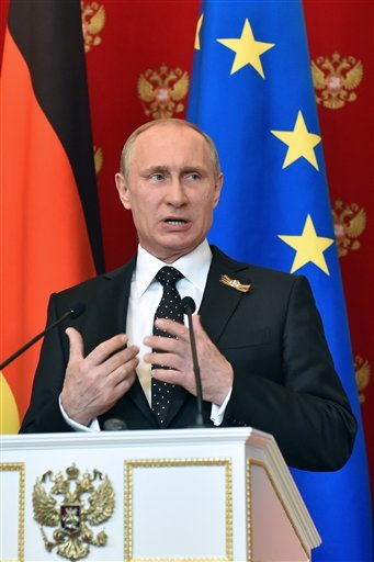 Russian President Vladimir Putin speaks at a joint news conference with German Chancellor Angela Merkel in the Kremlin in Moscow, Russia, Sunday, May 10, 2015. Angela Merkel has called during a visit to Moscow for Russia to do more to persuade separatists