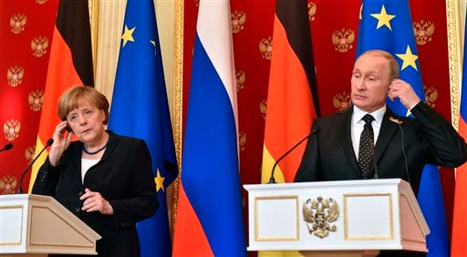 Russian President Vladimir Putin, right, and German Chancellor Angela Merkel attend a joint news conference in the Kremlin in Moscow, Russia, Sunday, May 10, 2015. Merkel has called during a visit to Moscow for Russia to do more to persuade separatists in