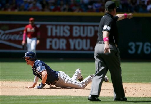 San Diego Padres' Wil Myers, left, falls down after colliding with Arizona Diamondbacks' Nick Ahmed as umpire Jim Joyce, right, points to the area where the two made contact during the fourth inning of a baseball game Sunday, May 10, 2015, in Phoenix. (AP