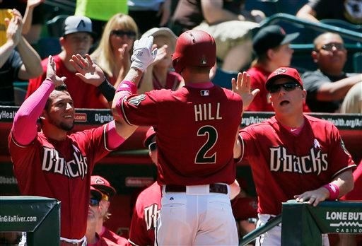 Arizona Diamondbacks' Aaron Hill (2) celebrates his home run against the San Diego Padres with David Peralta, left, and manager Chip Hale, right, during the second inning of a baseball game Sunday, May 10, 2015, in Phoenix. (AP Photo/Ross D. Franklin)