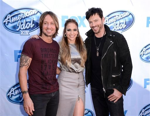 """In a Tuesday, Dec. 9, 2014 file photo, from left to right, singer Keith Urban, singer and actress Jennifer Lopez, and singer Harry Connick, Jr. arrive on set of """"American Idol"""" in Los Angeles. Fox announced announced Monday, May 11, 2015 that """"American Id"""