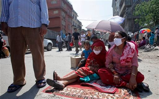 Nepalese people take refuge on a street after an earthquake hit Kathmandu, Nepal, Tuesday, May 12, 2015. A major earthquake hit Nepal in a remote region near the Chinese border on Tuesday, less than three weeks after the country was ravaged by another dea