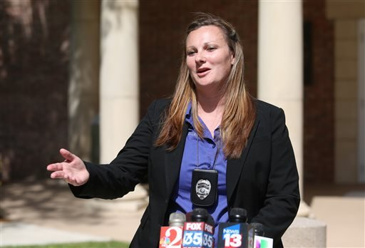 Binaca Gillette, a public information officer from the Lake Mary Police Department, conducts a news conference Monday, May 11, 2015, in Lake Mary, Fla., regarding a shooting incident involving George Zimmerman. Matthew Apperson, who authorities say was in