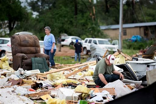 Ronnie Bevill sifts through the wreckage looking for anything salvageable from his aunts home Monday, May 11, 2015. A section of the D&J Mobile Home Park in Nashville, Ark., was destroyed after a EF2 tornado touched down late Sunday night. (Evan Lewis/The
