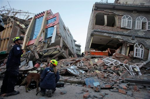 USAID rescue workers inspect the site of collapsed buildings after an earthquake in Kathmandu, Nepal, Tuesday, May 12, 2015.