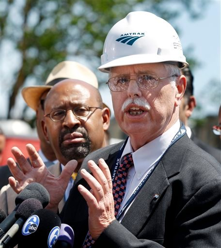 As Philadelphia Mayor Michael Nutter, left, listens Amtrak CEO, Joseph Boardman discusses Tuesday's deadly train derailment Thursday, May 14, 2015, in Philadelphia. An Amtrak train headed to New York City derailed and crashed in Philadelphia on Tuesday ni