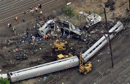 Emergency personnel work at the scene of a deadly train derailment, Wednesday, May 13, 2015, in Philadelphia. The Amtrak train, headed to New York City, derailed and crashed in Philadelphia on Tuesday night, killing at least six people and injuring dozens