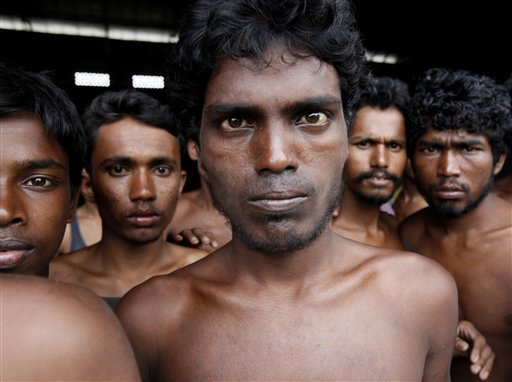 Newly arrived migrants gather at Kuala Langsa Port in Langsa, Aceh province, Indonesia, Friday, May 15, 2015. More than 1,000 Bangladeshi and ethnic Rohingya migrants came ashore in different parts of Indonesia and Thailand on Friday, becoming the latest