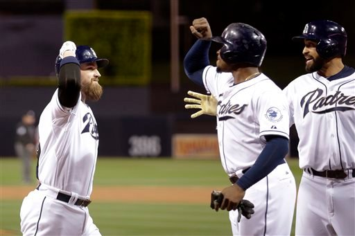 San Diego Padres' Derek Norris, left, is greeted by teammates after hitting a three-run home run, driving in Matt Kemp, right, and Justin Upton, center, against the Washington Nationals.