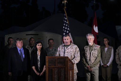 Lt. Gen. John E. Wissler, center, speaks during a press meet in Kathmandu, Nepal, Friday, May 15, 2015.