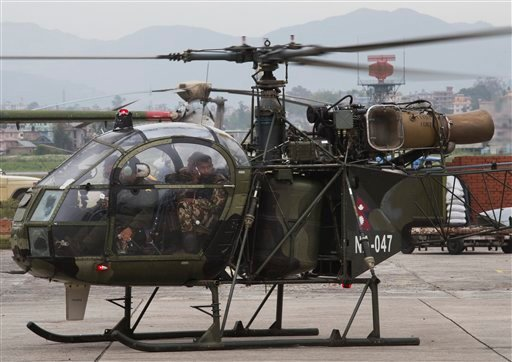 A Nepalese army chopper, that spotted the suspected wreckage of a U.S. Marine helicopter, lands at the airport in Kathmandu, Nepal, Friday, May 15, 2015.