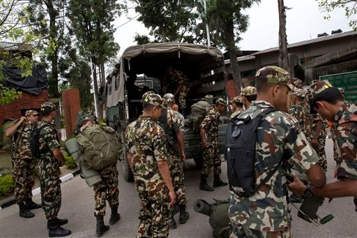 Nepalese army soldiers prepare to leave for a rescue mission to the site where the suspected wreckage of a U.S. Marine helicopter, that disappeared earlier this week while on a relief mission in the earthquake-hit Himalayan nation, was spotted.