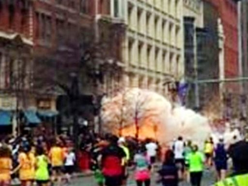 In this image from video provided by WBZ TV, a bomb explodes near the finish line of the Boston Marathon in Boston on Monday, April 15, 2013.