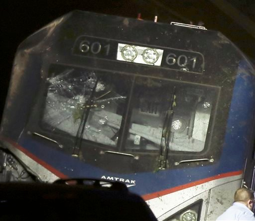 This May 12, 2015 photo shows a broken windshield of an Amtrak train after it derailed in Philadelphia. The FBI has been called in to investigate the possibility that the windshield of the train was hit with an object shortly before deadly train derailmen