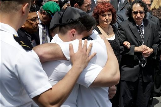 Howard and Susan Zemser, right, watch as midshipmen embrace during the the funeral service for their son U.S. Naval Academy midshipman Justin Zemser, Friday, May 15, 2015, at Boulevard-Riverside-Hewlett Chapel in Hewlett, N.Y. The 20-year-old sophomore wa