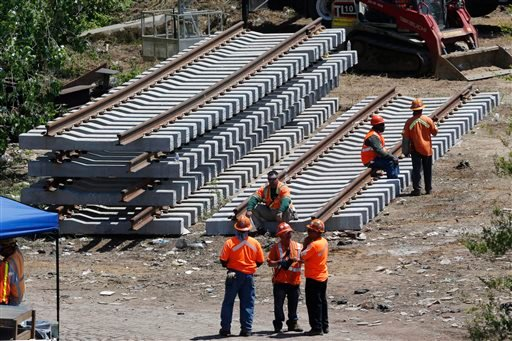 New rail lines are stacked up in an area near the site where a deadly train derailment occurred earlier in the week, Friday, May 15, 2015, in Philadelphia. Amtrak is working to restore Northeast Corridor rail service between New York City and Philadelphia