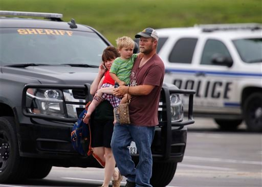 """People leave a restaurant next to a Twin Peaks restaurant Sunday, May 17, 2015, in Waco, Texas. Waco Police Sgt. W. Patrick Swanton told KWTX-TV there were """"multiple victims"""" after gunfire erupted between rival biker gangs near the restaurants. (Rod Aydel"""