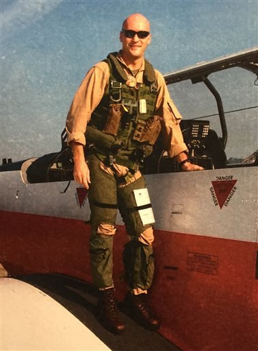 In this undated photo provided by the Norgren family, Marine Capt. Chris Norgren poses for a photo when he was in Navy flight school. Ronald Norgren, the father of Chris Norgren, the pilot flying a helicopter that went down in Nepal and disappeared Tuesda