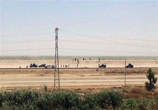 Iraq security forces withdraw from Ramadi, the capital of Iraq's Anbar province, 115 kilometers (70 miles) west of Baghdad, Sunday, May 17, 2015. Suicide car bomb attacks killed over 10 members of Iraqi security forces Sunday in Ramadi, which now is large