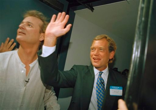"""In this Aug. 30, 1993 file photo, David Letterman, right, and Bill Murray wave from the side door of the Ed Sullivan Theater during the first episode of """"Late Show with David Letterman"""" in New York. After 33 years in late night and 22 years hosting CBS' """""""