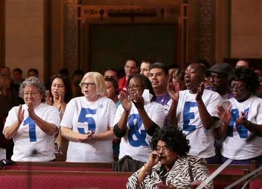 Supporters applaud during the minimum wage increase vote as the Los Angeles City Council votes to raise the minimum wage in the city to $15 an hour by 2020. (AP Photo/Damian Dovarganes)