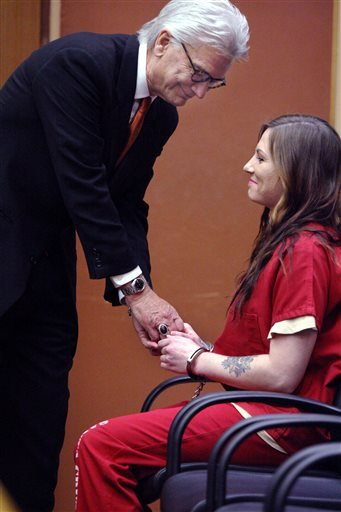 Defense attorney Jerry Christiansen greets his client, Alix Tichelman, right, Tuesday, May 19, 2015 in Santa Cruz, Calif.