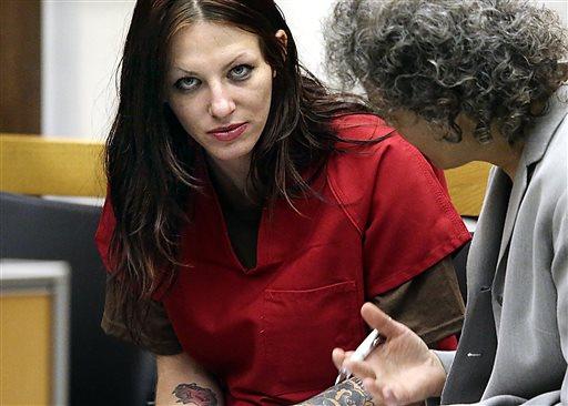 In this July 9, 2014 file photo, Alix Tichelman, left, of Folsom, Calif., confers with public defender Diane August during her arraignment in Santa Cruz Superior Court in Santa Cruz, Calif.
