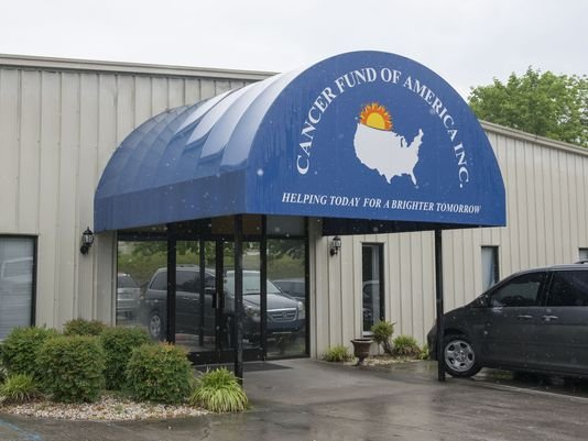 In this Monday, May 18, 2015 photo, the headquarters of the Cancer Fund of America is shown in Knoxville, Tenn.