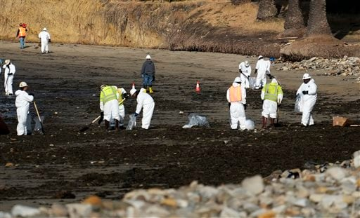 Clean up crews remove oil-laden sand on the beach at Refugio State Beach, site of an oil spill, north of Goleta, Calif., Wednesday, May 20, 2015. (AP Photo/Michael A. Mariant)
