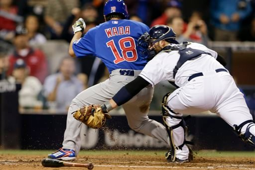 Chicago Cubs' Tsuyoshi Wada (18) scores on a triple by Dexter Fowler as San Diego Padres catcher Derek Norris applies the tag too late during the fifth inning in a baseball game Wednesday, May 20, 2015, in San Diego.