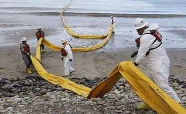 Workers prepare an oil containment boom at Refugio State Beach, north of Goleta, Calif., Thursday, May 21, 2015. More than 7,700 gallons of oil has been raked, skimmed and vacuumed from a spill that stretched across about 9 miles of California coast, just