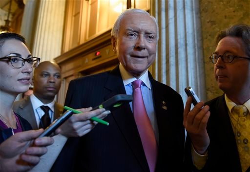 Sen. Orrin Hatch, R-Utah. is surrounded by reporters as he walks to a luncheon with other Senate Republicans on Capitol Hill in Washington, Friday, May 22, 2015. Supporters of President Barack Obama's trade agenda hope to fend off hostile Senate amendment