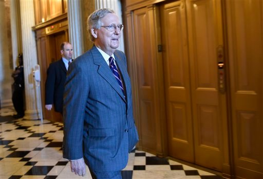 Senate Majority Leader Mitch McConnell of Ky. walks to a Republican luncheon on Capitol Hill in Washington, Friday, May 22, 2015. Supporters of President Barack Obama's trade agenda hope to fend off hostile Senate amendments Friday and send a major trade