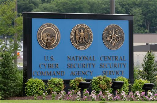 In this June 6, 2013 file photo, a sign stands outside the National Security Agency (NSA) campus in Fort Meade, Md. The Justice Department warned lawmakers that the National Security Agency will have to wind down its bulk collection of Americans' phone r