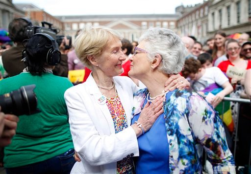 Irish Senator Katherine Zappone, right, and partner Ann Louise Gilligan celebrate as the first results in the Irish referendum start to filter through at Dublin Castle, Ireland, Saturday, May 23, 2015. Ireland has voted resoundingly to legalize gay marria