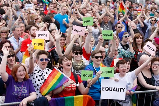Yes supporters celebrate after as the first results start to filter through in the Irish referendum in Dublin, Ireland, Saturday, May 23, 2015. Ireland has voted resoundingly to legalize gay marriage in the world's first national vote on the issue, leader