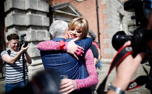 Rory O'Neill, known by the Drag persona Panti, celebrates with Colm O'Gorman, executive director of Amnesty International in Ireland, at Dublin Castle, Ireland, Saturday, May 23, 2015. Ireland has voted resoundingly to legalize gay marriage in the world's