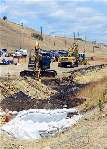 This May 22, 2015 photo from the U.S. Coast Guard shows excavation equipment and contaminated soil at the site of the pipeline break in the hills above Refugio Beach north of Goleta, Calif. The pipeline that leaked thousands of gallons of oil on the Santa