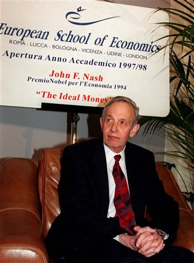 In this Oct. 28, 1997 file photo, John Forbes Nash, 1994 Economics Nobel Prize winner, takes a break during the European School of Economics conference in Rome. Nash, the Nobel Prize-winning mathematician whose struggle with schizophrenia was chronicled