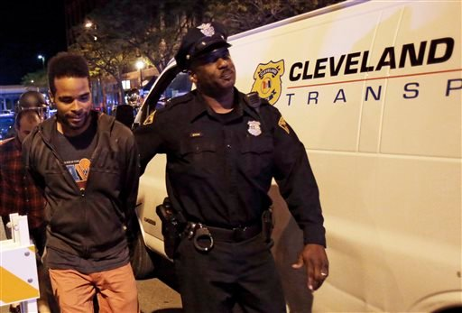 A protester is arrested after the acquittal of Michael Brelo, a patrolman charged in the shooting deaths of two unarmed suspects Saturday, May 23, 2015, in Cleveland. Brelo, who fired down through the windshield of a suspect's car at the end of a 137-shot