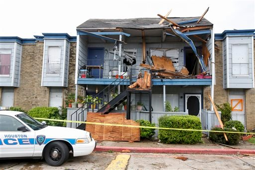 Police tape off an area after roof collapsed during a morning storm Sunday, May 24, 2015 in Houston at the Rockport Apartment Homes on S. Gessner. (Eric Kayne/Houston Chronicle via AP)