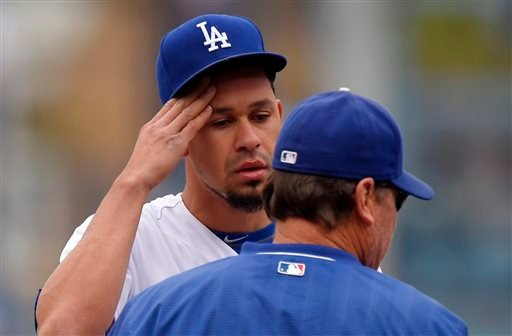 Los Angeles Dodgers relief pitcher Carlos Frias, left, talks with pitching coach Rick Honeycutt during the first inning of a baseball game against the San Diego Padres, Sunday, May 24, 2015, in Los Angeles. (AP Photo/Mark J. Terrill)