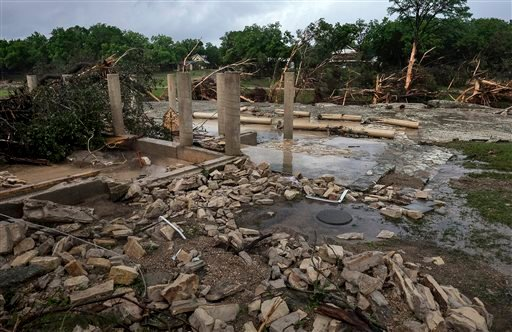 The cement stilts of the home belonging to the Carey family of Corpus Christi, Texas, are all that remain the home was swept away by the Blanco River early Sunday morning during a flash flood in Wimberley, Texas, on Monday, May 25, 2015. The Carey and McC