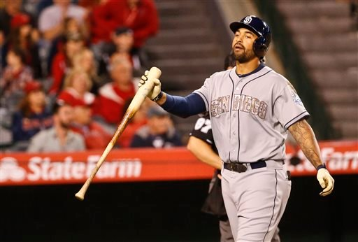 San Diego Padres designated hitter Matt Kemp reacts after striking out with the go ahead run on base in the seventh inning of a tied baseball game against the Los Angeles Angels Monday, May 25, 2015, in Anaheim, Calif. (AP photo/Lenny Ignelzi)