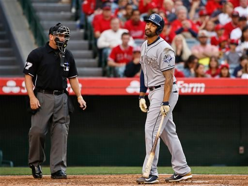 San Diego Padres designated hitter Matt Kemp reacts after being called out on strikes with two runners on base in the fourth inning of a baseball game against the Los Angeles Angels, Monday, May 25, 2015, in Anaheim, Calif. The home plate umpire is Scott