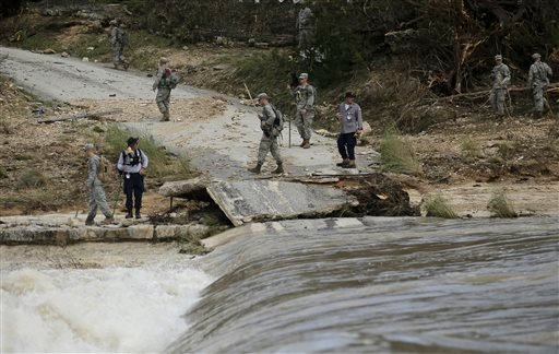 Members of the National Guard and a search and rescue team work along the Blanco River, Tuesday, May 26, 2015, in Wimberley, Texas. (AP Photo/Eric Gay)