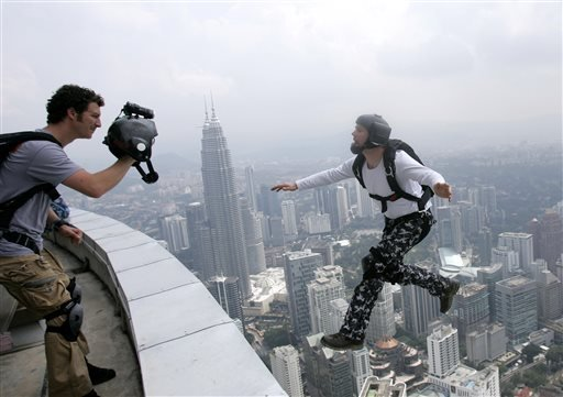 Oct. 24, 2009 file photo: An unidentified BASE jumper leaps from the height of 300 meters off of Malaysia's landmark KL Tower, the 421-meter (1,381-foot) broadcasting tower, in Kuala Lumpur, Malaysia. (AP Photo/Lai Seng Sin, file)