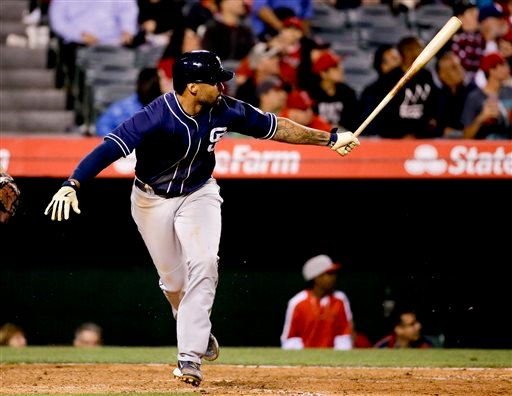 San Diego Padres' Matt Kemp watches his three-run double against the Los Angeles Angels during the 10th inning of a baseball game in Anaheim, Calif., Tuesday, May 26, 2015. (AP Photo/Chris Carlson)