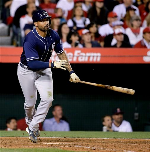 San Diego Padres' Matt Kemp watches his RBI single against the Los Angeles Angels during the seventh inning of a baseball game in Anaheim, Calif., Wednesday, May 27, 2015. (AP Photo/Chris Carlson)